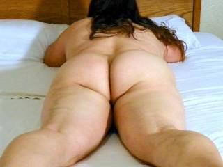 I AM looking at her ass....I would love to straddle her thighs, play with her naked ass, run my cock between those cheeks, then do it some more!
