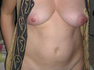 Beautiful breasts, nipples, and quite a tasty bush too.  Love it!