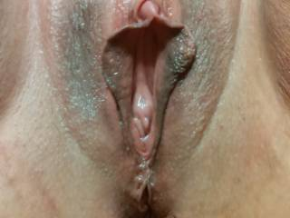 Was sucking her hard clit making he squirm and buck. Beautiful pussy don\'t you think?