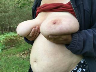 A nice woodland scene; she stands holding tits up