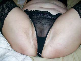 My chubby wife\'s hairy pussy thing to poke through her sheer panties.