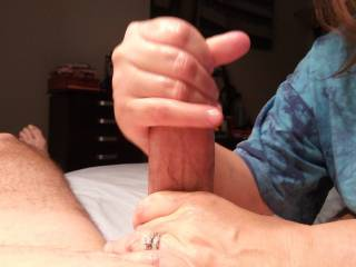 I love stroking my man\'s very thick cock. It is lovely when my man explodes in my hand, leaving his beautiful cum all over my fingers. Mmm...