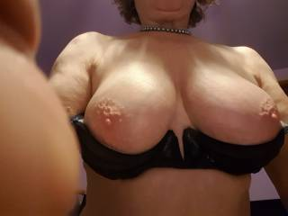 Busty mature Irene shows her tits