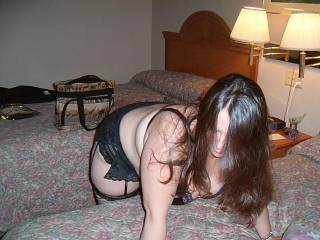 she is bent over getting ready for us guys to take her..you like her bent over like that ?