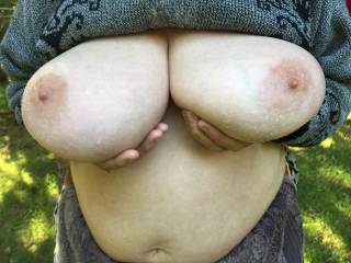 Water view - what a view. Lovely big tits with water droplets on both them and the fingers holding them up