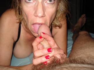 Love the red nails, Love the BIG cock knob end and love this ladies eyes! Sexy as heck! xxx