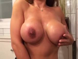 The only thing wrong with that video is the fact that I wasn't in it with you rubbing MY cum into your big beautiful tits with the swollen head of my throbbing cock! That is after you squeeze your amazing tits around the thick veiny shaft of my rock hard cock and use your huge melons to milk me until I cum like a geyser all over your pretty face,sexy neck and of course your gorgeous tits!