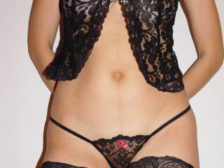 I love wearing sexy clothes, designed to set a man on fire... A lace top covering my breast, a mini sheer thong hiding my trimmed pussy and black stockings... Dressed but still so nude, revealing the perfect amount of flesh... Do you find it HOT enough?