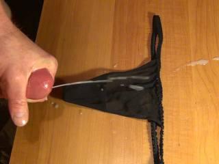Cumming on my GF's black thong panties. 2 weeks of cum.