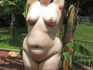 My wife enjoying the warm sun on her pale curvy body.