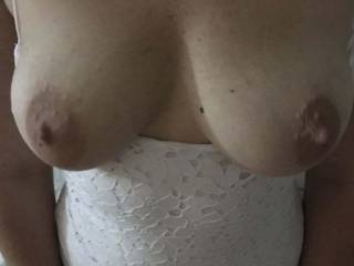 My nipples are so hard and my pussy is so wet as My bf takes this photo of my tits just before we had a visitor to fuck me while my bf watches x