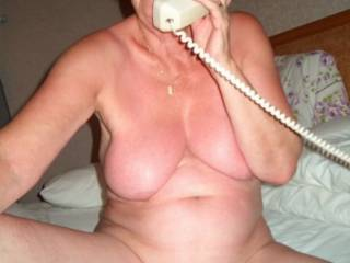 Could I suck you gorgeous tits and finger your sweet pussy while you take your call sexy lady?