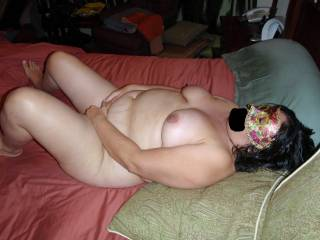 I bought this mask one day while feeling very sexy and horney! Thought I would surprise hubby with a mysterious and sexy look! Now here I am totally nude and fully exposed masturbating for your pleasure only wearing my mask! Do you like what you see?