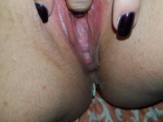 Playing with ny sweet wet pussy.