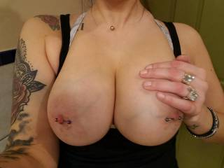 Showing off her huge tits