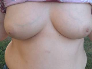 Wife flashing me her fantastic tits. Someone won\'t to give a cumtribute?