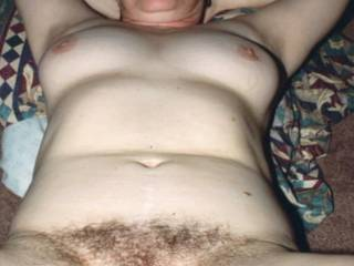 Horny, hairy housewife constantly fantasizing about having 2 or more guys working her hairy cunt and hungry asshole at the same time! She is so proud of her full all natural thick bush. She also fantasizes about having her spread nude photos ejaculated on