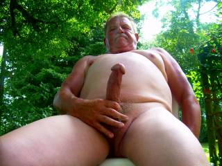 Dirty old man jacking off in the back yard.
