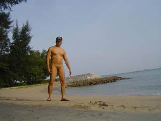 Strolling nude on the beach