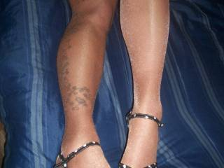 my wifes legs in shiny pantyhose and heels