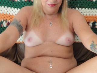 WOW!!! Love those sexy white bits ;-)  Gorgeous tits, sweet pink nipples, smooth suckable spread pussy and that cock-hardening smile !