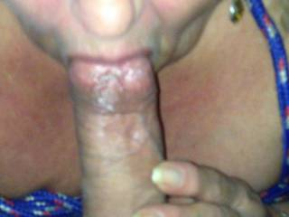 Tied her tits and told her to get down on her knees and she started doing what she loves to do.  She loves sucking my cock.  She can almost swallow me all the way to my balls now.  Pretty soon she will suck my cock and tickle my balls with her tongue.
