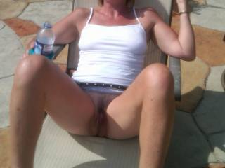 Flashing her pussy on the patio