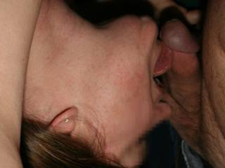 Licking right below the head