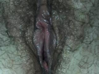 Kiki's hairy pussy after I fucked her with my cock and came in her and then fucked her cum filled pussy with her giant dildo!