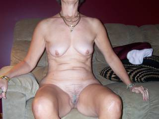 Here\'s my wife totally naked and looking proud. She just loves having men see her with her clothes off and its way hotter for her if that man knows her. And lots of them have. What would you do if she sat in front of you like this?