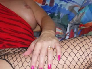 Pink fingernails on fishnets, tit in the background.  MMMMM - she is soooooo hot!