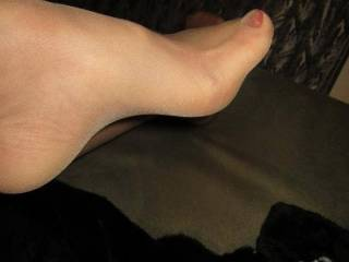 Her nylon feet after a long day at work