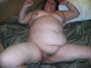 Big belly, hairy pussy, suck able tits,  just doesn't get any better.  mmmm