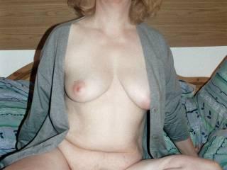 posing nude in bed