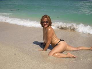 Exquisite gorgeous woman mind blowing hot erotic pose showing off your sexy hot body has me wanting to take you right there on the beach with the waves rolling over us.