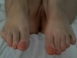 Well that would certainly work for me! Would love to have those beautiful sexy toes up against me to sniff lick kiss and suck as I filled your gorgeous pussy with my hot hard throbbing cock.... Great shot! :)