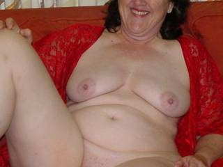 full body shot sitting with legs spread showing tits and pussie