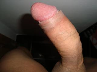 My hard cock with its foreskin pulled back!