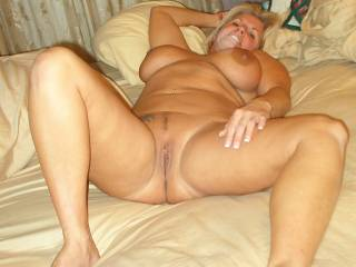 On the bed with my legs spread for you !