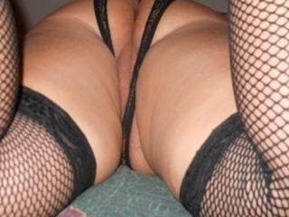 Another sexy ass shot of wife dressin up for . Wearing fishnets and another pair of crotchless panties for easy access and a nice view, What would you do if I were to share her?