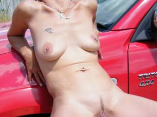 Oooo that would be so much fun eating that pussy up against that truck... what a sexy hot woman.  K & G