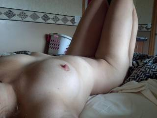 Stretched out an feeling sexy.  Who wants to spread my legs open and eat my pussy?