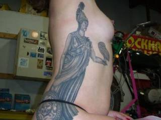 you can see the tattoo as it rises up  your curves  hi hose tight to your body and you are very beautiful
