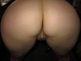 That fussy lil pussy actually =) i would LOVE to see it super smooth and in a thong....But you can show your bum off to me any time as its really hot for a lovely mature woman...