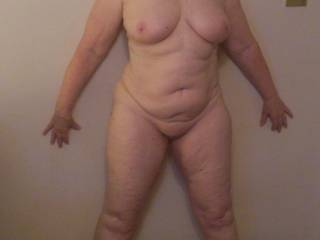 WOW! ... love her beautiful voluptuous body, & the way she is standing is a real turn on!  Wish I was there to give her a fresh load of cum!