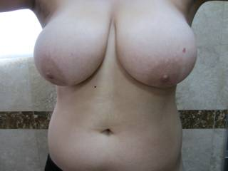 I love them...thinking about sliding my cock between those beautiful breasts right now. Do you enjoy having a hard cock sliding between your breasts?