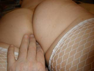 hubbys hand going in the back door,can you handle this ass????