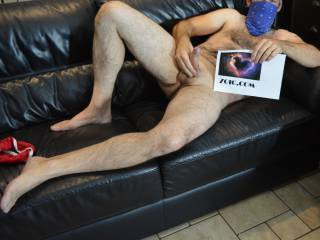 masturbating bandit style on a leather couch