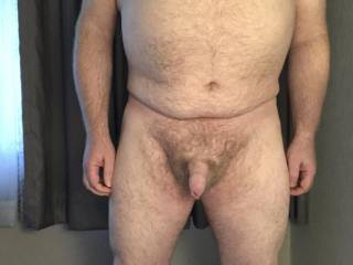 Hairy and uncut, just a small dick on a big guy
