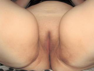 My wife\'s plump, smoothly shaven pussy mound ready for someone to plant their face in it!